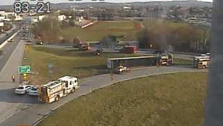 First responders respond to an overturned tractor-trailer on the exit 21 ramp to Route 30 on Interstate 83 on Friday, March 25, 2016.