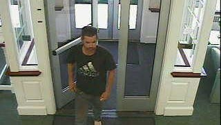 A man without shoes allegedly held up a Woodbury Heights Bank. He remains at large.