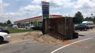Clarksville Police have said to avoid the Peachers Mill and Tiny Town Road intersection.  A dump truck hauling what appears to be dirt and gravel has overturned and spilled the load onto the road near a gas station.