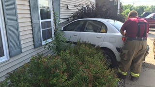 Car crashed into Riverhill Apartments in Omro on Tuesday, Aug. 30, 2016.