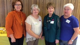 Shown from left are speaker Nora Chambers and hostesses Martha Davis, Frances Andrews and Maggie Rushton.