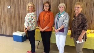 Pictured from left are door prize winner Wanda Miller, meeting speaker Nora Chambers, and door prize winners Judy Brunson and Genny Cole.