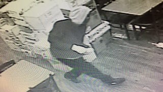 Police have released surveillance images of the suspects in the Wednesday morning robbery of Southfield Grill.