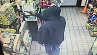 Surveillance from robbery at Exxon gas station.