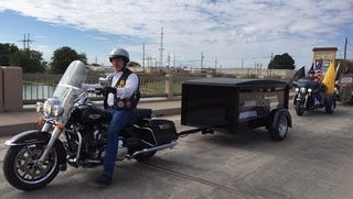 Out-going Eddy County Sheriff Scott London sits on his motorcycle outfitted with a hearse.