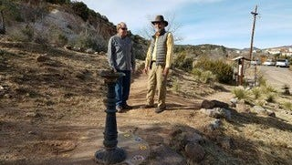 Silver City Mayor Ken Ladner (left) and long-time trail advocate Joseph Gendron evaluate the Spring Street trail head at Boston Hill.