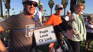 A CV Link supporter and his dog, Boo, outside Palm Springs City Hall in April.