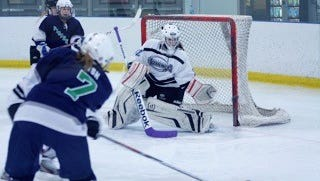 Goalie Maddie Marciw, shown making a save for the Suburban Icebreakers girls hockey team in this undated photo, is one of the players committed to the new Livonia United high school squad.