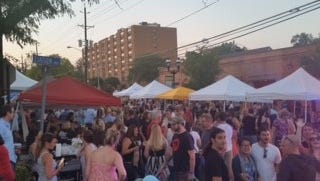 A crowd enjoys the evening on Station Avenue during the 2016 Sippin' on Station event in Haddon Heights.