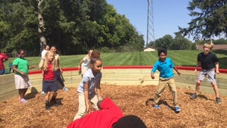 Kids play in a gaga ball pit at Murdock Elementary School.