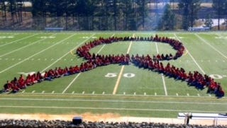 Students at Ruidoso Middle School celebrate Red Ribbon Week with a live formation.