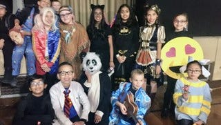School 9 5th graders, who will graduate in June, took place in their last Trunk or Treat and posed for a photo near the end of the night.