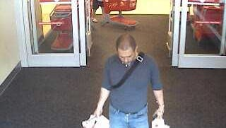 Surveillance video shows a man suspected of using stolen credit cards walk out of a Target at Coconut Point Mall in Estero on Sunday, Nov. 3, 2017.