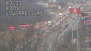 Traffic remains slow following a single-vehicle crash on I-83.