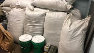 Part of the 800 pounds of damiana leaves and other compounds for making synthetic marijuana that police intercepted Tuesday afternoon. Five people were arrested in suspicion of being involved in drug dealing operations.