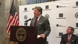 AllianceBernstein CEO Seth Bernstein announces the company's headquarters relocation last year. State officials would not release any details about tax credits awarded to the money management company.