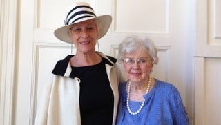 Ann Duncan (left), president of The Community House Women's Club, and historian Marion Beck celebrate the group's 25th anniversary. Beck has kept albums containing details and photos of activities over the years.