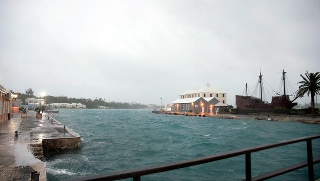 Wind brought by Hurricane Nicole makes water break over the dock on Ordnance Island in St. Georges, Bermuda, Thursday, Oct. 13, 2016. The hurricane had strengthened to a Category 4 storm late Wednesday but lost some steam overnight. However, forecasters warned that it was still extremely dangerous.