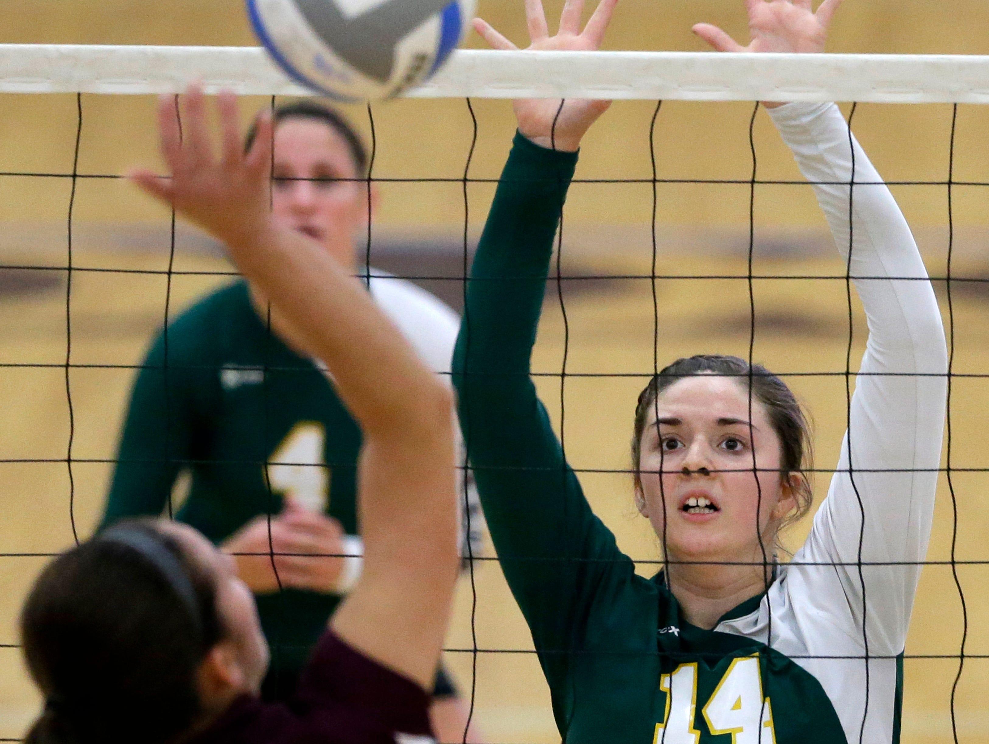 Fox Valley Lutheran High School's Amber Schroeder looks to get a hit past Freedom High School's Mercedes Heenes Tuesday, Oct. 20, 2015, in Appleton, Wis.