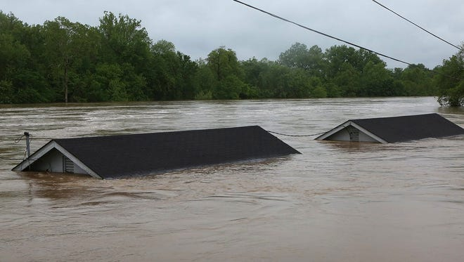 Two rental houses look underwater next to the Meramec River in Fenton, Mo., on May 3, 2017.