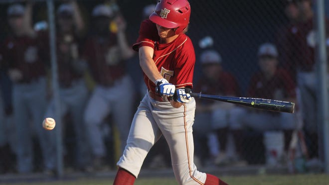 Florida High's Destin Todd tries to square up a pitch while at bat against Rickards.