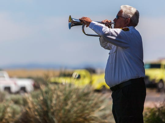Hamblin Valley Fire Chief Jack Horner plays taps on the bugle during the memorial dedication of Tanker 11 and pilots Todd Tompkins and Ron Chambless at the Cedar City airport, Friday, June 3, 2016.
