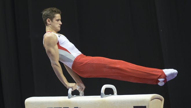 Alec Yoder, Indianapolis, competes in the pommel horse, which he placed fifth in, following a last-round fall in the event, U.S. National Gymnastics Championships, Bankers Life Fieldhouse, Sunday, August 16, 2015.