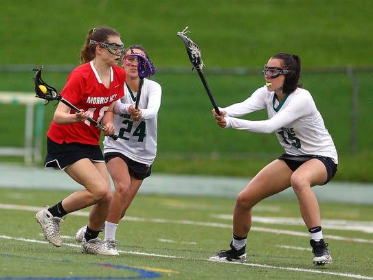 Morris Hills' Jenna Draney goes in to score vs. Montville