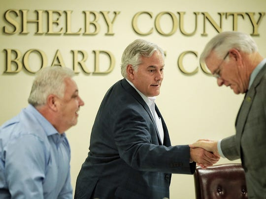 Shelby County Mayor Mark Luttrell, right, greets Commissioners Terry Roland, left, and budget committee chairman Steve Basar before presenting the county's budget to the Shelby County Commission.
