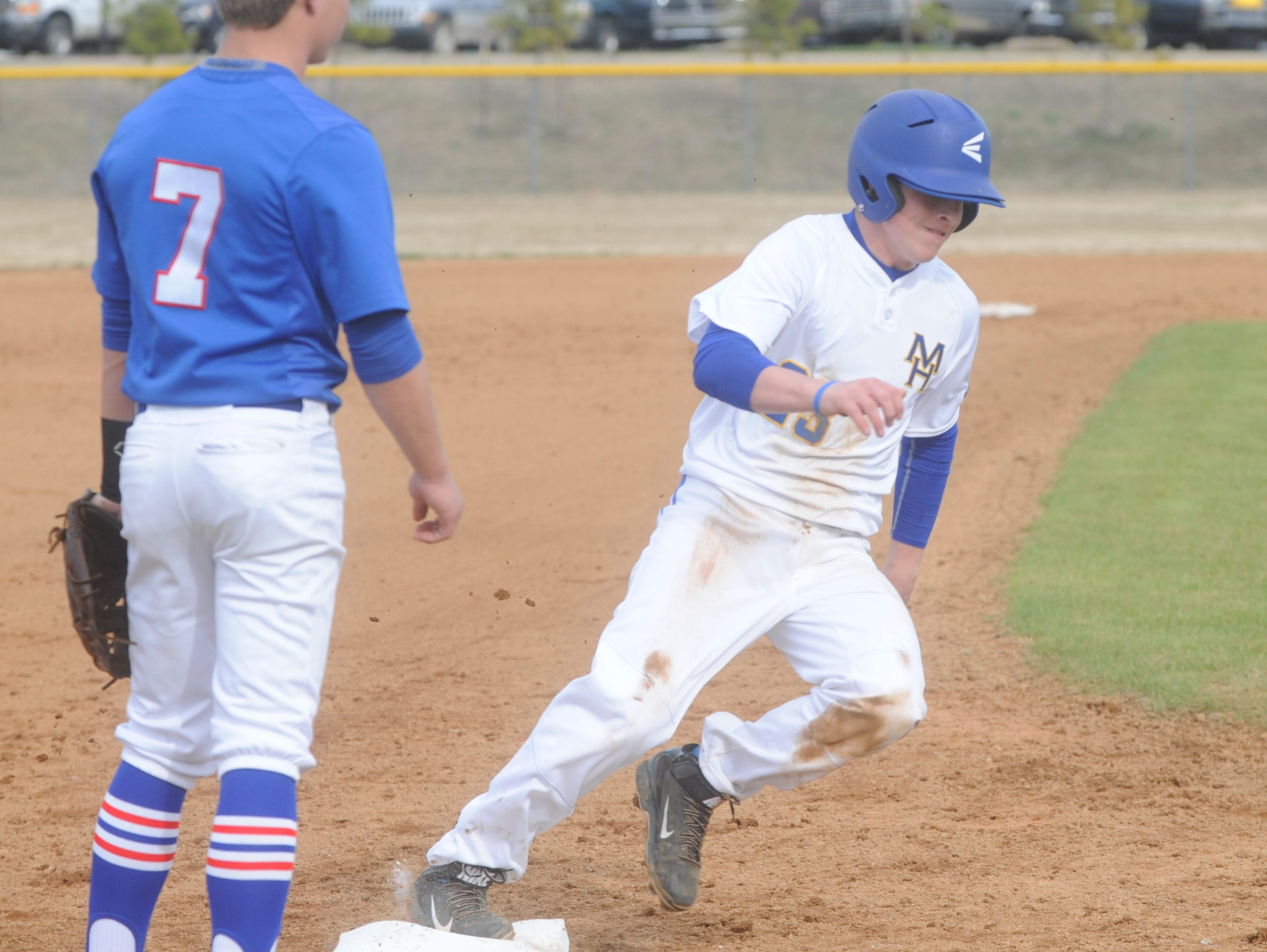 Mountain Home's Marshall Roberson rounds third base on his way to score against West Memphis in a recent game at Cooper Park.