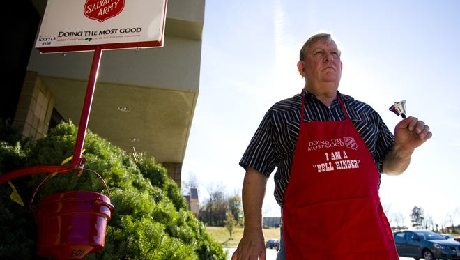 Larry DeHamer rings a bell at a Salvation Army kettle outside a Springfield grocery store.