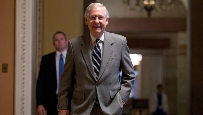 In this July 20, 2017, photo, Senate Majority Leader Mitch McConnell of Ky. walks into the Senate Chamber at the Capitol in Washington.