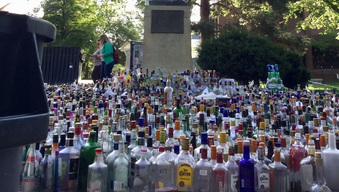 Bottles surround the statue of John Mackay at the University of Nevada, Reno on May 10, 2018.