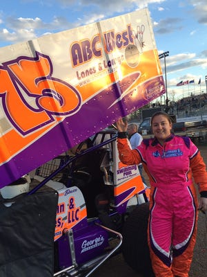 Nicole Bower stands next to her No. 75 410 Sprint car.
