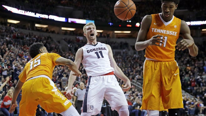 Gonzaga forward Domantas Sabonis (11) reacts after he dunked against Tennessee forward Kyle Alexander, right, and guard Detrick Mostella, left, in the second half Saturday.