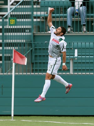 Rochester's Jonny Mendoza leaps in the air after his second half goal against the NY Red Bulls II to help the Rhinos to a 2-1 win.