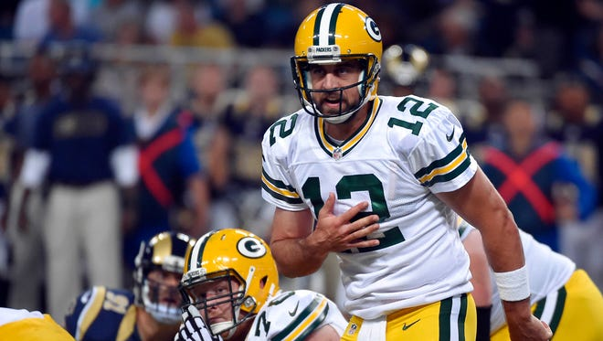 Green Bay Packers quarterback Aaron Rodgers (12) calls a play against the St. Louis Rams during the first half at Edward Jones Dome.