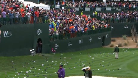 Fans litter the course on the 16th hole after Francesco Molinari's hole in one during the third round of the Waste Management Phoenix Open.