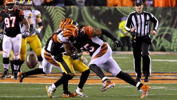 Cincinnati Bengals outside linebacker Vontaze Burfict  hits Pittsburgh Steelers wide receiver Antonio Brown in the head with his shoulder on Saturday,