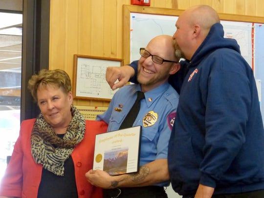Ruidoso firefighter William Green, center, was recognized