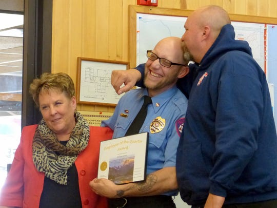 Ruidoso firefighter William Green, center, was recognized as public safety employee of the quarter. At left is Village Manager Debi Lee and at right, Fire Chief Harlan Vincent.