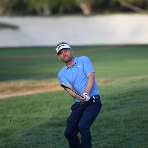 Shane Lowry of Ireland strikes the ball on the third fairway in round two of the Abu Dhabi Championship golf tournament in Abu Dhabi, United Arab Emirates, Thursday, Jan. 17, 2019. (AP/Martin Dokoupil)