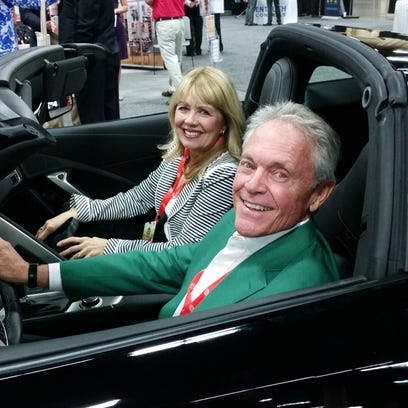 Tom Barnett and his wife, Georgia, sit in the Corvette