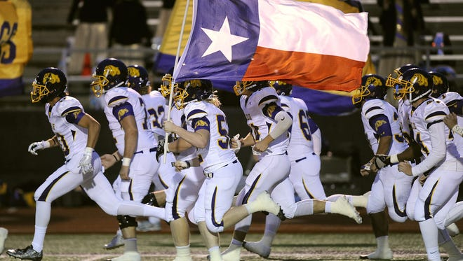 Wylie players take the field before the Bulldogs' game against Brownwood on Oct. 7, 2016, at Gordon Wood Stadium in Brownwood.