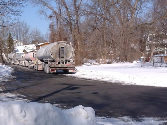 In this photo dated February 18, 2015, tractor trailers line up on River Road near the Bottini Fuel petroleum products terminal in New Hamburg.