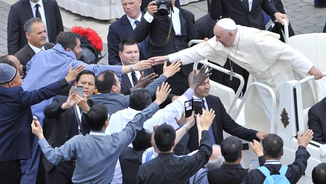 Pope Francis greets the faithful after leading a Mass during a Jubilee for Priests at St Peter's Square in the Vatican on June 3, 2016.