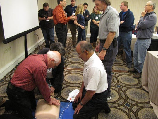 Volunteer EMS workers take part in a certification training course at the EMS Council of New Jersey annual symposium at the Sheraton Parsippany.