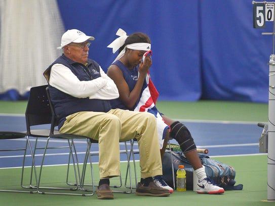 O'Gorman tennis coach Don Barnes sits with Danielle