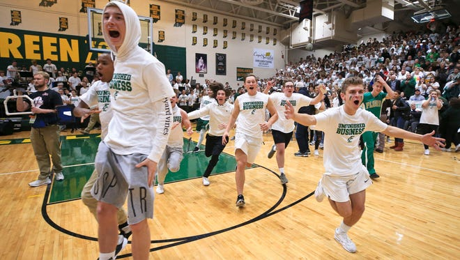Floyd Central students celebrate the Highlanders' 49-47 win over New Albany in overtime Friday evening. It was the Highlanders first win against New Albany since 2003.