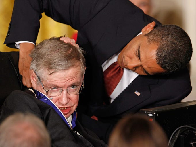 President Barack Obama (R) presents the Medal of Freedom